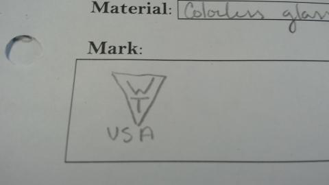 "Upside down triangle with letters ""WT"" in it, and USA underneath"
